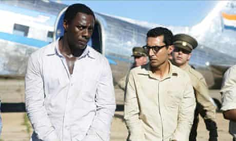 Idris Elba and Riaad Moosa as Nelson Mandela and Ahmed Kathrada in Mandela: Long Walk to Freedom.