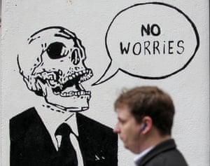 A shopper walks pass graffiti in Dublin, Ireland on December 11, 2013.