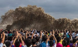Visitors Take Pictures Of Tidal Waves Under The Influence Typhoon Usagi In Hangzhou