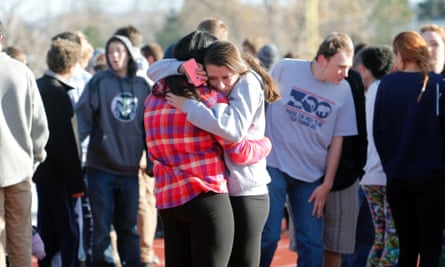 Students at Arapahoe high school comfort each other.