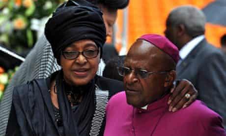 Nelson Mandela's former wife Winnie with Desmond Tutu at Mandela's national memorial service