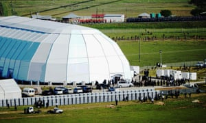 Funeral guests and members of the South African Defence Forces prepare for Nelson Mandela's funeral on his family's property, in Qunu, South Africa.