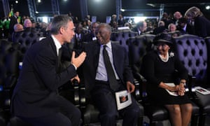 Former South African president Thabo Mbeki talks with Norway's former Prime Minister Jens Stoltenberg.