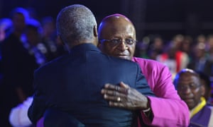 Archbishop Desmond Tutu, right is greeted by former South African president Thabo Mbekifor.