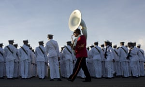 Members of the Navy get ready before the funeral ceremony begins