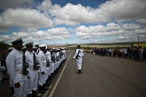 Members of the South African Navy line up on the roadside near by the funeral service.