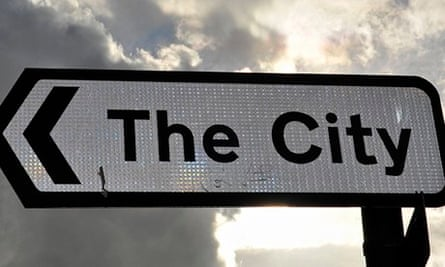 A sign points to the City of London financial district, in London