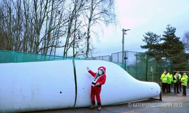 Protester dressed as Santa next to wind turbine placed by activists at Barton Moss drilling site operated by IGas