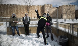Young Palestinians throw snowballs at the Jaffa Gate at the Old City of Jerusalem, Israel, 13 December 2013. Reports state that a snow storm crossing Israel has flooded roads, felled trees and delayed public transportation. Severe winter weather is forecast for the coming days.