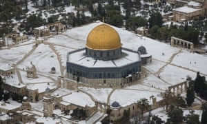 Snow covers the Dome of the Rock at the Al-Aqsa mosque compound in Jerusalem's old city, Israel. Heavy storms continued throughout Israel on Saturday, causing traffic disruptions and power outages across the country.