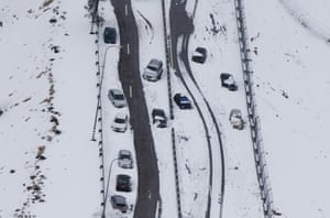 Cars sit stuck during a snow storm on one of the two main highwaysonthe outskirts of Jerusalem, Israel.