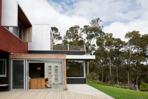 Homes - Perth House: exterior of architecturally designed house with trees in background