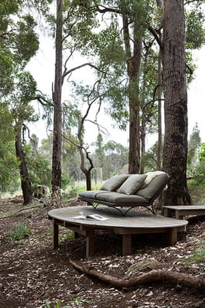 Homes - Perth House: sofa on table in middle of forest