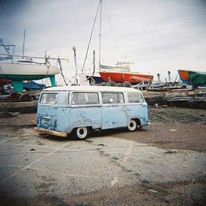VW camper vans: old VW camper van parked near harbour
