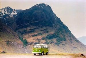 VW camper vans: green VW camper in front of mountains