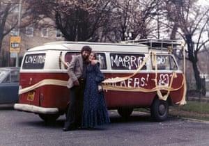 VW camper vans: married couple in front of VW camper
