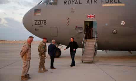 David Cameron gets off plane at Camp Bastion