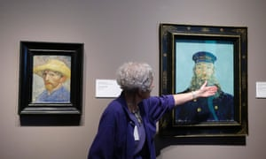 A self-portrait and the Portrait of Postman Roulin by Van Gogh displayed at the museum in Detroit.