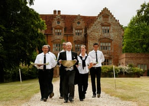 Butler training school: George Telford and trainee butlers carry punch and canapes