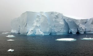 Antarctica Live: an iceberg shining with electric blue light