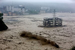 Extreme weather: heavy flood waters sweeping through Beichuan in China's Sichuan province