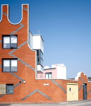 Islington Square … an exuberant brick wall surrounds clever family housing in Manchester
