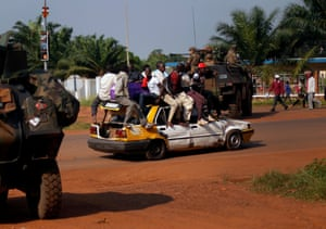 16 Dec: An overloaded taxi drives past a French checkpoint in Bangui. More than 1,600 French troops have been deployed in an effort to end sectarian violence. At least 600 people have been killed since Anti-Balaka launched a strike over Bangui last week before being pushed back