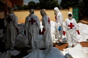 8 Dec: Red Cross staff stand amid dozens of bodies at the morgue in Bangui. French forces fanned out across the town as Seleka forces kept up their patrols despite an order to return to their barracks