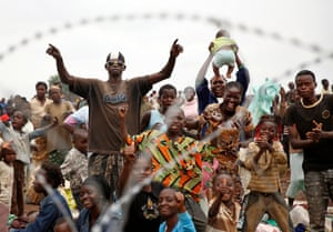 6 Dec: Internally displaced people at Bangui's airport cheer as French military helicopters land, a day after a gun battle between Seleka soldiers and  Christian militias left more than 100 dead and scores wounded.