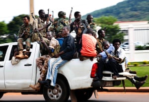 5 Dec: Seleka soldiers race through Bangui as gunfire and mortar rounds erupt in the town.