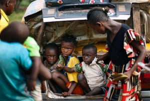 4 Dec: Christian children from the village of Bouebou, 30 miles north of Bangui, sit in the boot of a taxi as they flee sectarian violence
