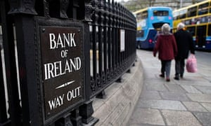 Shoppers pass the Bank of Ireland in Dub