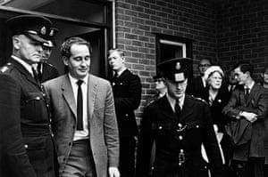 Ronnie Biggs update: 1965: Biggs leaves Aylesbury Police Station under heavy guard