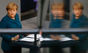 German Chancellor Angela Merkel is refected in a glass barrier as she addresses the German lower house of parliament Bundestag in Berlin after beginning her third term as Chancellor.