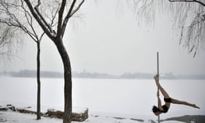 Extreme pole dancing as a pole dancer practices in the snow in Tianjin during a promotional event by members of China's national pole dancing team and students of the sport. China set up its first national pole dancing team in 2012 in order to compete in the World Pole Dancing Championships.