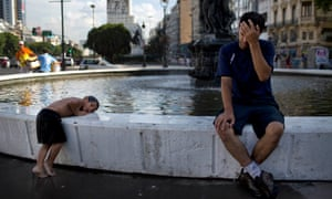 Daniel Britez endures the high temperatures as his son Alejandro, 4, cools down in a fountain in Buenos Aires, Argentina. Power outages are plaguing Buenos Aires as temperatures soar above 95 degrees and everyone tries to turn on their air conditioners at once.