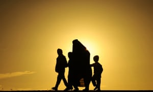 A family walks during sunset in Herat, Afghanistan.