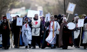 King Arthur Pendragon, a senior Druid, leads a protest march to the new Stonehenge visitor centre in protest at English Heritage's display of ancient human remains excavated from the area near Stonehenge in Wiltshire, UK.