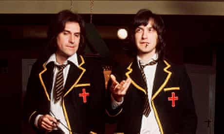 Ray Davies and Dave Davies of The Kinks in school uniform for 'Schoolboys In Disgrace', January 1976
