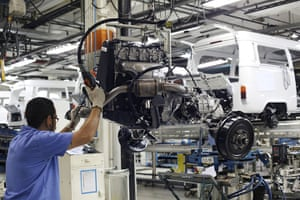 Volkswagen campers: A staff member moves the engine on the assembly line