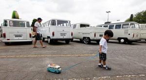 Volkswagen campers: A boy pulls along his Volkswagen Kombi toy