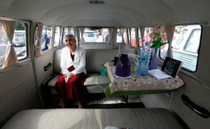 Volkswagen campers: Marcilia Coelho sits inside her van