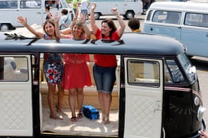 Volkswagen campers: Visitors cheer inside a Volkswagen Kombi minibus