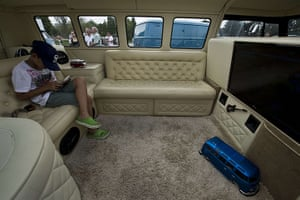 Volkswagen campers: A boy plays with a tablet inside a Kombi