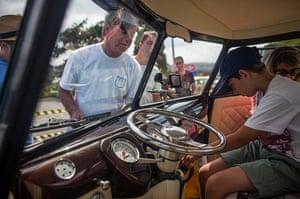 Volkswagen campers: Visitors inspects the interior of a custom Volkswagen Kombi minibus