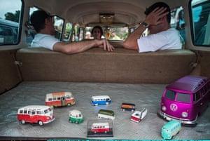 Volkswagen campers: Exhibitors rest inside a Volkswagen Kombi minibus with toy models