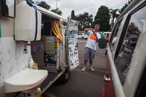 Volkswagen campers: A man takes a photograph of the inside of a van