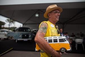 Volkswagen campers: Collector Marcos da Silva carries a miniature Volkswagen