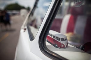 Volkswagen campers: A replica toy Volkswagen Kombi minibus sits on the dashboard