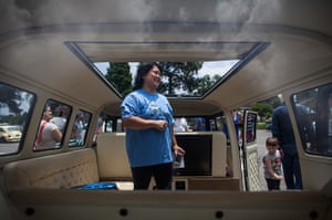 Volkswagen campers: A woman checks out the interior of a custom built Volkswagen Kombi minibus